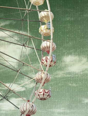 spinning wheel: abstract vintage picture of carnival ferris wheel