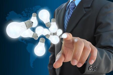businessman hand holding light bulb Stock Photo