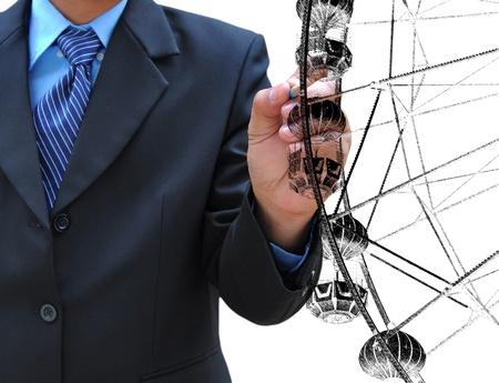 spinning wheel: businessman hand drawing ferris wheel Stock Photo