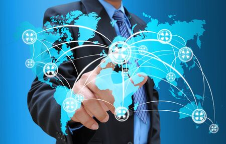 businessman hand pushing social network on world map photo
