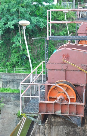old motor driven of dam photo