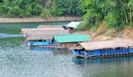 Hut homestay on water in thai dam photo