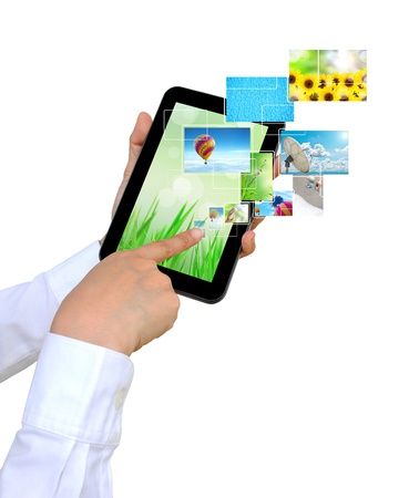 touch pad: touch pad PC and streaming images virtual buttons on women hand Stock Photo