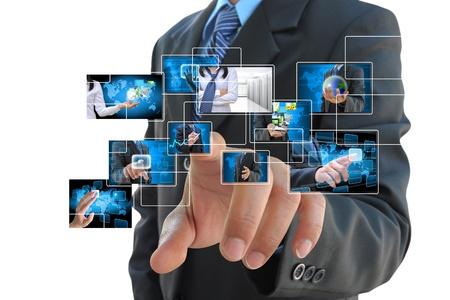実業家の手のタッチ画面のインターフェイスのボタンを押して 写真素材