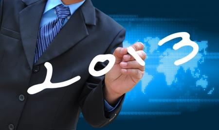 businessman hand writing 2013
