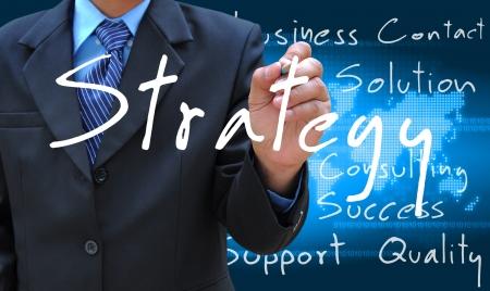 businessman hand writing strategy