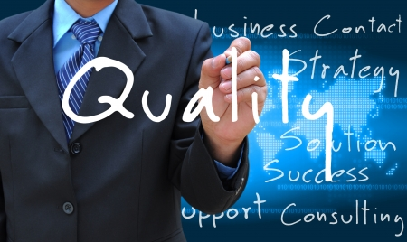 businessman hand writing quality photo