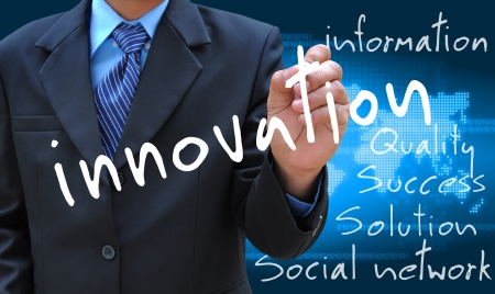 new media: businessman hand writing innovation Stock Photo