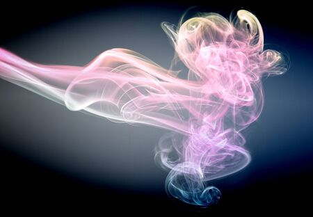 Abstract glowing of smoke isolated on black photo