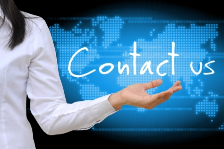 contact info: working women hand holding contact us