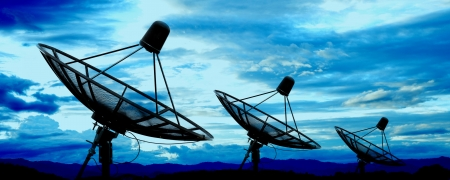 wireless: satellite dish antennas under blue sky