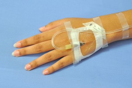 IV solution in a patients hand photo