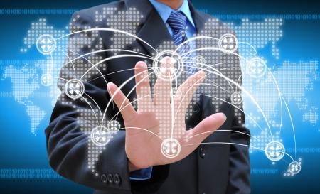businessman hand pushing social network on world map Stockfoto
