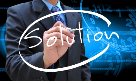 businessman hand writing solution