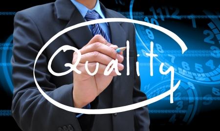 quality guarantee: businessman hand writing quality