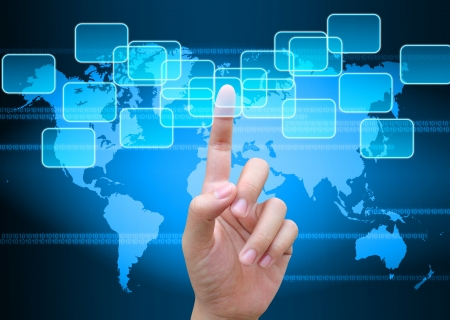 global innovation: hand pushing button on a touch screen interface