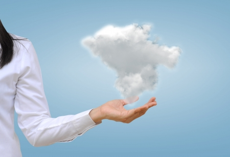 cloud transfer: hand holding a cloud Stock Photo