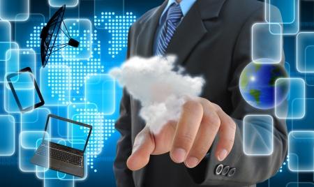 実業家の手のタッチ画面のインターフェイスをクラウドにプッシュ 写真素材