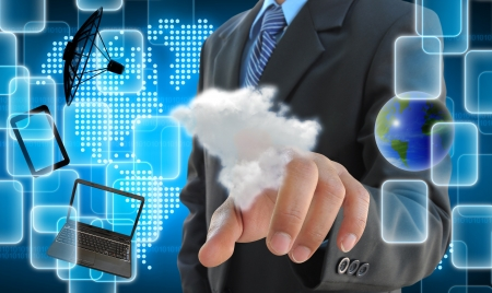 share information: businessman hand pushing a cloud on a touch screen interface Stock Photo