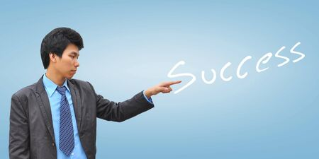 businessman hand pushing success Stock Photo - 18348852