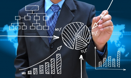 smart investing: businessman hand drawing business graph