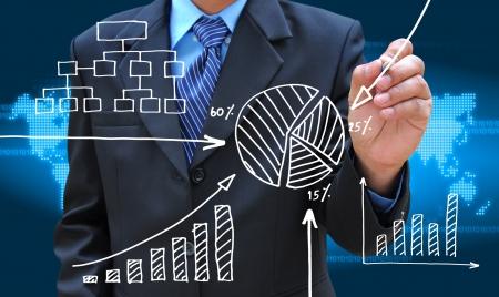 financial gains: businessman hand drawing business graph