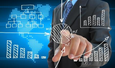 사업가 손 터치 스크린 인터페이스에 비즈니스 그래프를 밀어 스톡 콘텐츠