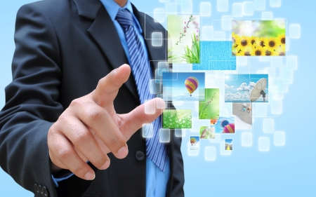 paper screens: businessman hand holding streaming images virtual buttons