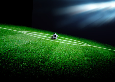 soccer ball on grass: soccer field and the bright lights Stock Photo