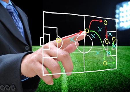 coach sport: plan of soccer manager at soccer field