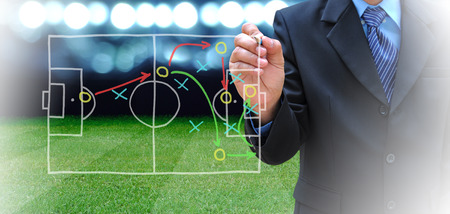 plan of soccer manager at soccer field photo