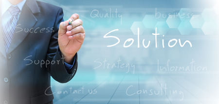 businessman hand writing solution photo