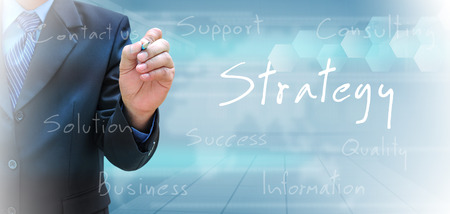 businessman hand writing strategy photo