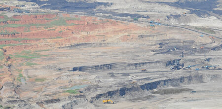 open pit mining of coal and working machinery photo