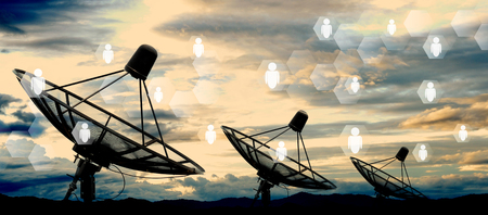 satellite dish antennas on sky and social network Stockfoto