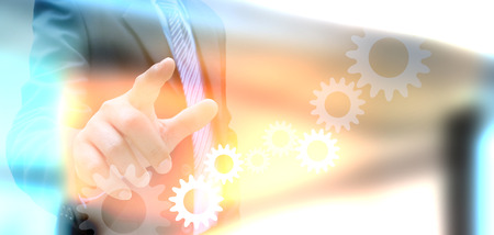 background information: businessman hand drawing business graph and cog gear