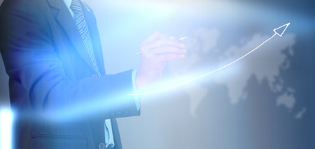 businessman hand writing a business graph photo