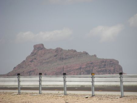 Desert Cliff Beyond a Highway Stock Photo - 18408951