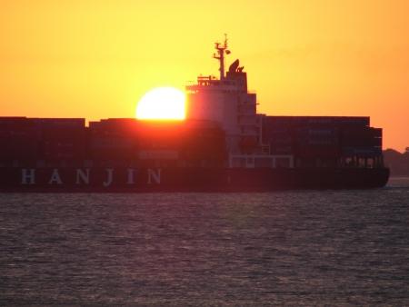 Sunset over a Cargo Ship