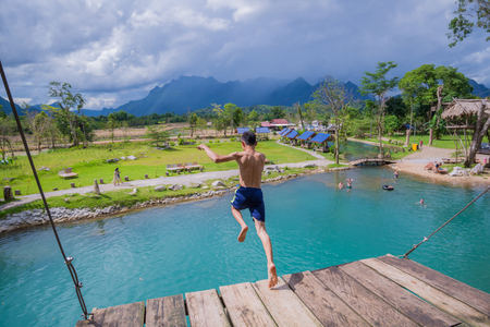 Man jumping in water with Blue lagoon of lao. Places to visit Vang Vieng-Lao Zdjęcie Seryjne