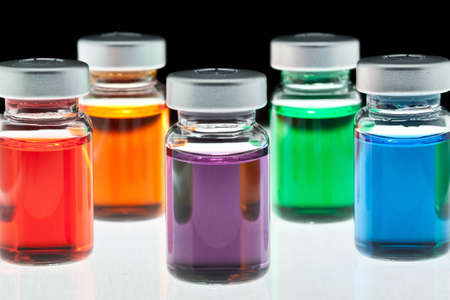 injectable: Various coloful medication vials ready for use. Stock Photo