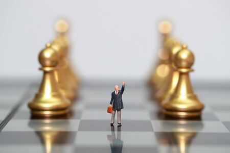 Chess business with miniature businessman people idea for competition, success and leadership concept (business using as background)