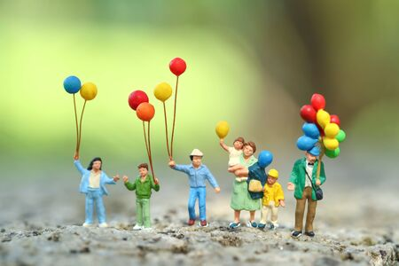 Miniature people: traveler standing in park outdoor, Business concept using as background