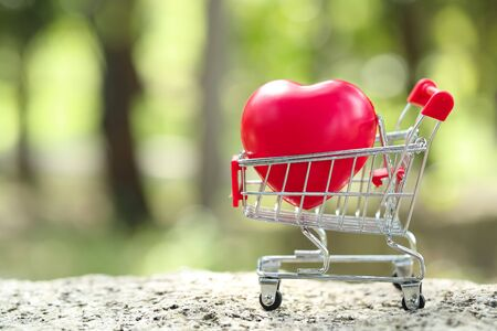 trolley with heart, idea for shopping using as business background