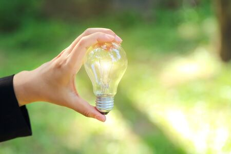 businesswoman holding electric glass bulb, idea for business innovation and inspiration concept using as background Stok Fotoğraf