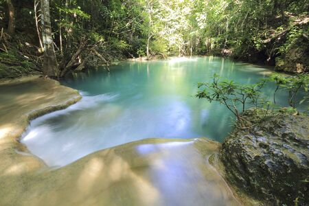 water fall in nature with green trees in Kanchanaburi, Thailand Stok Fotoğraf