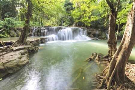 water fall in nature with green trees in Kanchanaburi, Thailand Stok Fotoğraf - 132391984