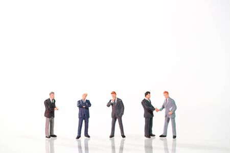 Miniature people: a group of businessman standing on white background (this image for financial and business competition concept) Stok Fotoğraf - 132391991