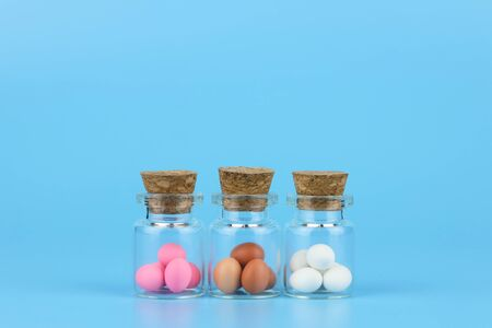 decorated easter eggs in bottle with blue background