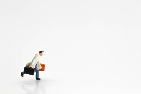 Miniature people: businessman running on white background Stok Fotoğraf - 132392616